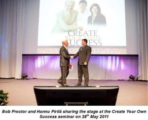 Bob Proctor and Hannu Pirila on Stage 28052011 with text